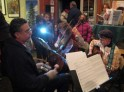 The Loosely Knits captivated audiences with strings, bells, and winter tunes. Photo by Frog Mom