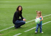 CARSON, CA - MARCH 29:  Mia Hamm looks on as her daughter plays with a ball prior to the match between the Washington Freedom and the Los Angeles Sol at The Home Depot Center on March 29, 2009 in Carson, California. (Photo by Robert Laberge/Getty Images)