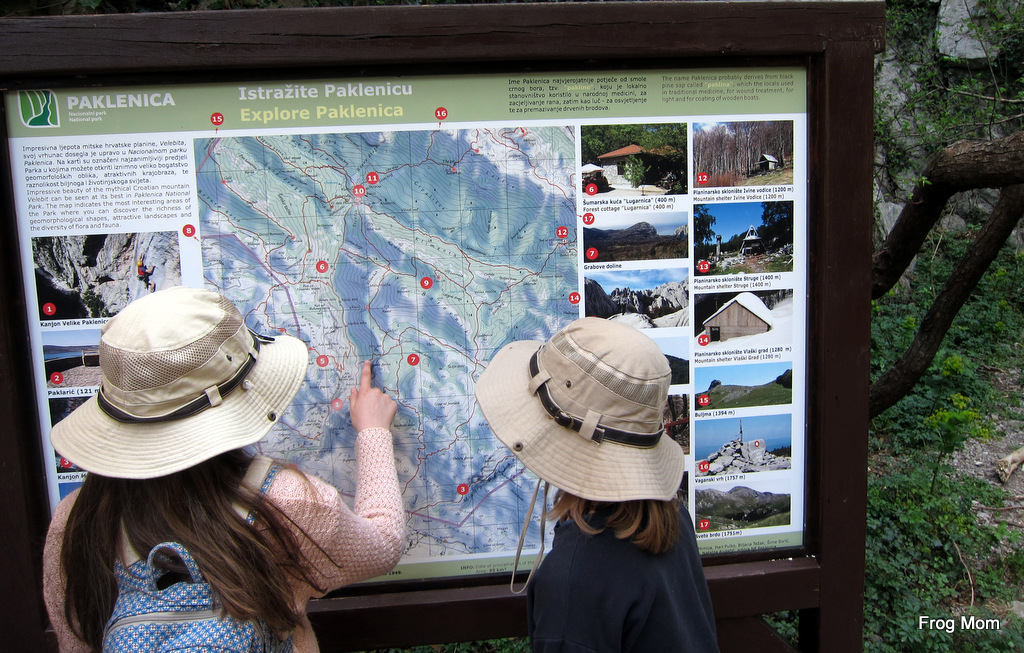 Croatia with kids hiking paklenica national park my girls run to the first board that displays a large map of the park what should we do the paklenica hut being a red dot at the top of a narrow publicscrutiny Images