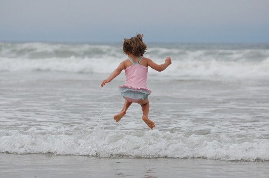 Things to do at the beach with kids - Jump over waves
