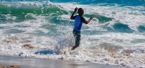Things to do at the beach with kids - Swim in the sea