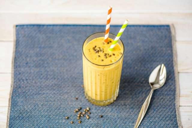 Pumpkin smoothie with straw