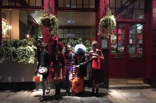 Halloween in London - kids in costume in front of pub in Fulham