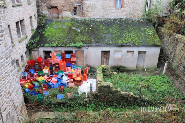 Trash pile in backyard, Mont St Michel