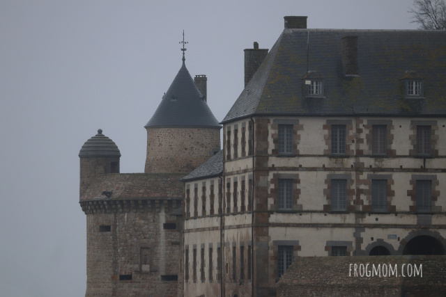 Stone walls of Mont St Michel in the fog