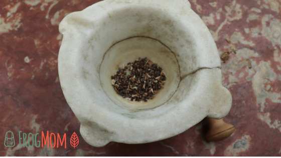 Cardamom seeds in a mortar