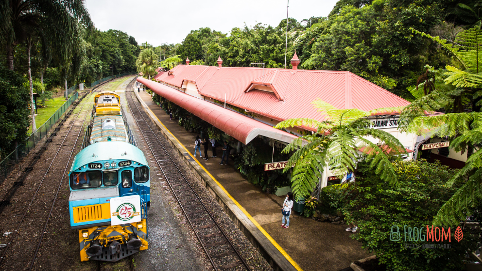 Scenic train at the platform in lush tropical countryside