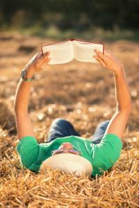 Man reading book in a meadows