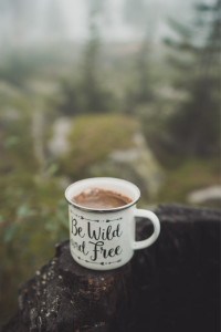 Tin cup with hot chocolate in nature